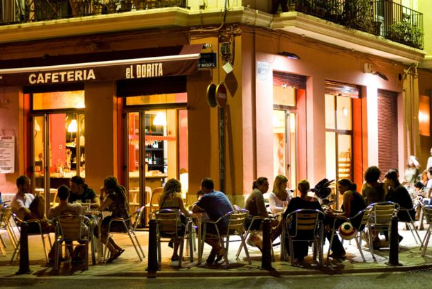 Customers drinking outside a bar in Spain