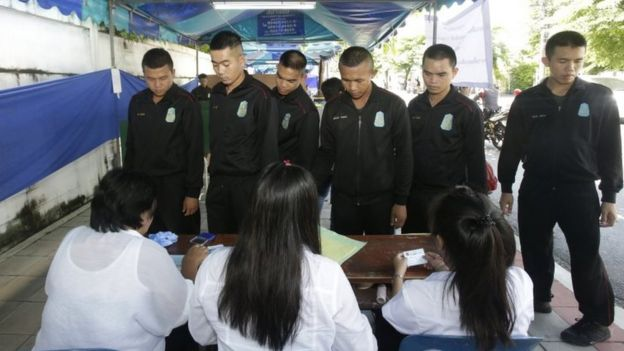 Thai soldiers queue up to vote at a polling station in Bangkok.