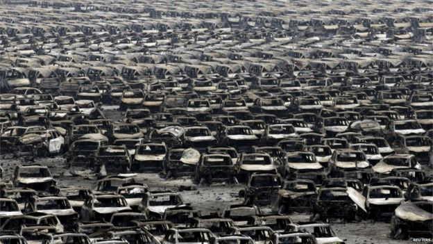 Damaged cars are seen near the site of the explosions at the Binhai new district, Tianjin, 13 August 2015.