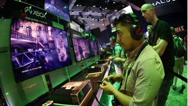 Gamer Jonathan Martinez tests a new 'Gears of War' game at the Xbox display on the second day of the Electronic Entertainment Expo, known as E3 at the Convention Center in Los Angeles, California on June 17, 2015