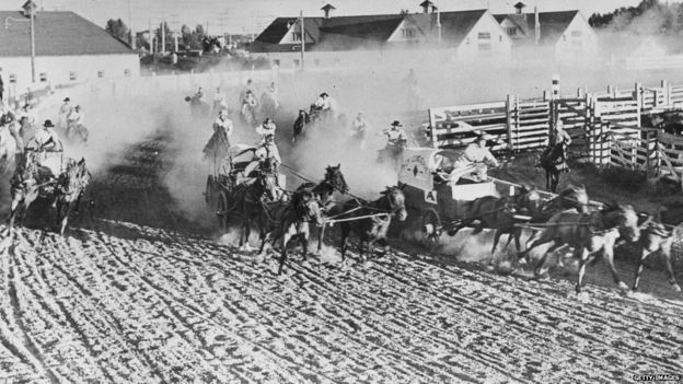 A chuck wagon race at the Calgary Stampede, Canada, 1938