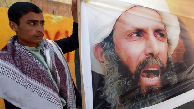 A Yemeni protester holds a picture of Sheikh Nimr in 2014