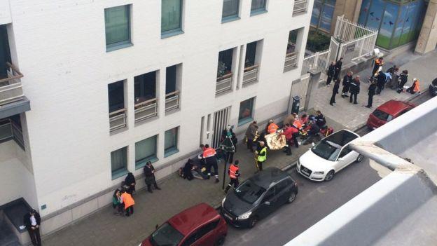 People being treated by medics at Maalbeek metro station