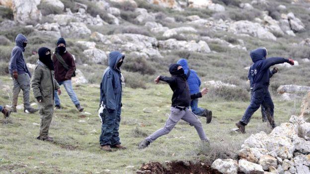 Protesters throw stones during an operation to evacuate the unauthorised settlement outpost of Amona in the occupied West Bank (1 February 2017)