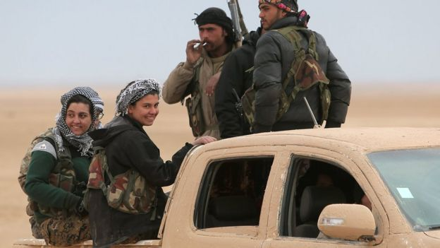 Syrian Democratic Forces (SDF) fighters ride on a vehicle north of Raqqa, Syria (5 February 2017)