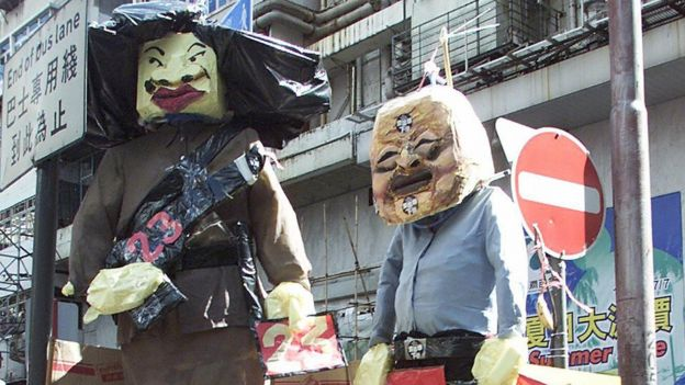 Effigies of Ms Ip and Chief Executive Tung Chee-hwa during the 1 July 2003 protest
