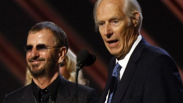 Ringo Starr and George Martin giving an acceptance speech at the Grammy awards in Los Angeles