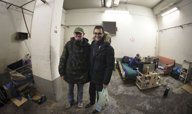 Arash Derambarsh with a homeless Polish man in Courbevoie, Paris