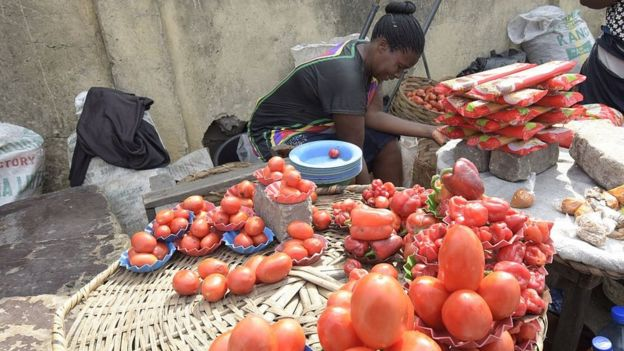 A vendor arranges tomatoes on display in the Obalende district of Lagos, on May 25, 2015