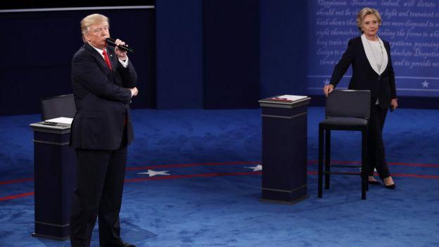 Republican U.S. presidential nominee Donald Trump looks on as Democratic U.S. presidential nominee Hillary Clinton speaks during their presidential town hall debate at Washington University in St. Louis, Missouri, U.S., October 9, 2016.