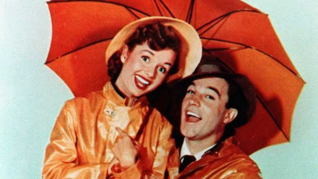 An undated file photo shows US actor Gene Kelly with actress Debbie Reynolds in the movie Singin' in the Rain