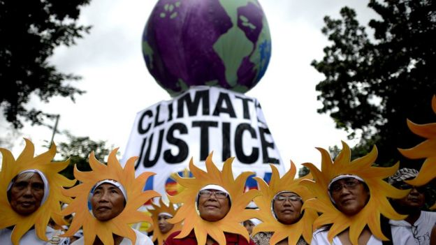Protesters attend a climate change march in Manila, Philippines on 28 November 2015