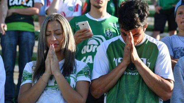 People pay tribute to the players of Brazilian team Chapecoense Real who were killed in a plane accident in the Colombian mountains, at the club
