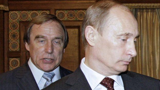 Sergei Roldugin (L) and Vladimir Putin, pictured in 2009