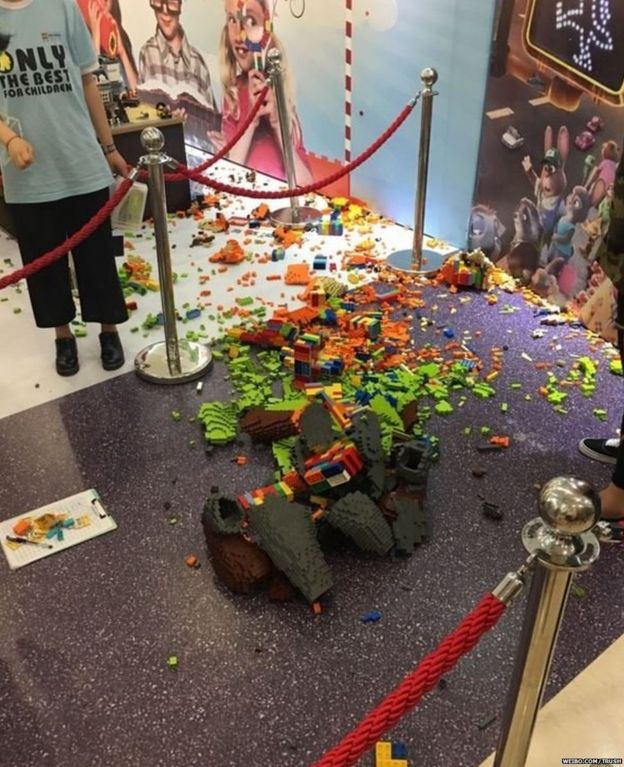 Photo of broken statue of Nick from the film Zootopia at the LEGO expo in China.