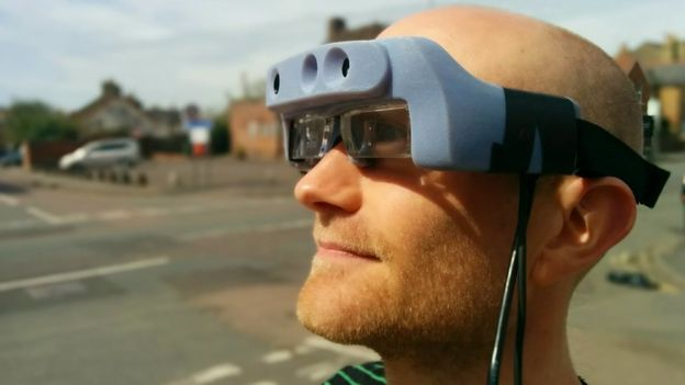 Man wearing prototype smart glass for the visually impaired