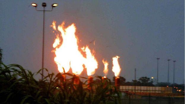 A view of the gas flames at Mobil oil terminal 30 May 2002, at Ibeno, southern Nigeria.