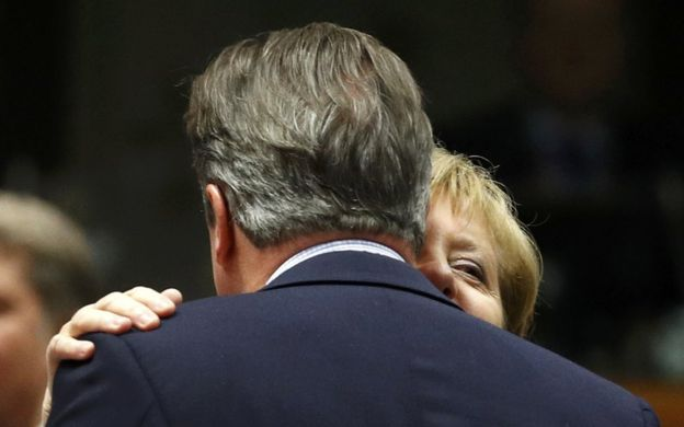 UK Prime Minister David Cameron is embraced by German Chancellor Angela Merkel in Brussels, 28 June