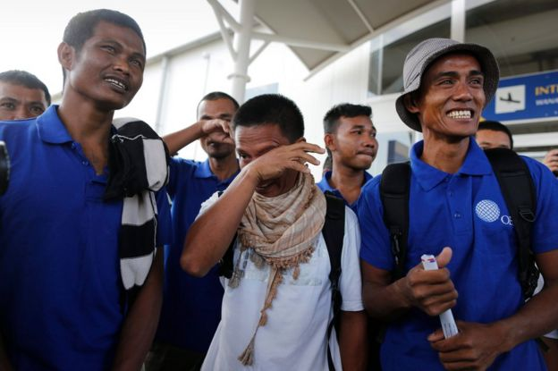 Unidentified sailors react upon their arrival at the Jomo Kenyatta International Airport after they were released by Somali pirates, Nairobi, Kenya, 23 October 2016.