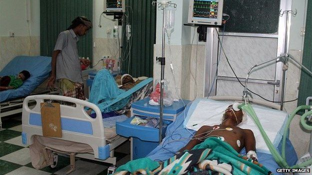 Men lie injured in hospital after being injured in clashes in Aden