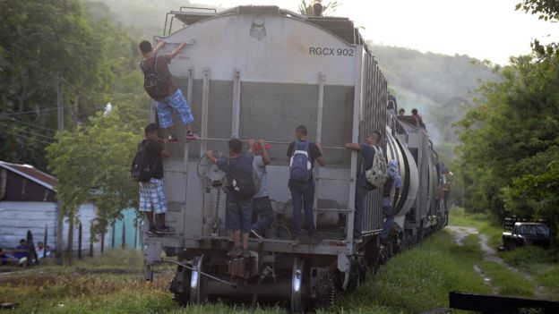 Migrants hitch rides through Mexico on freight trains