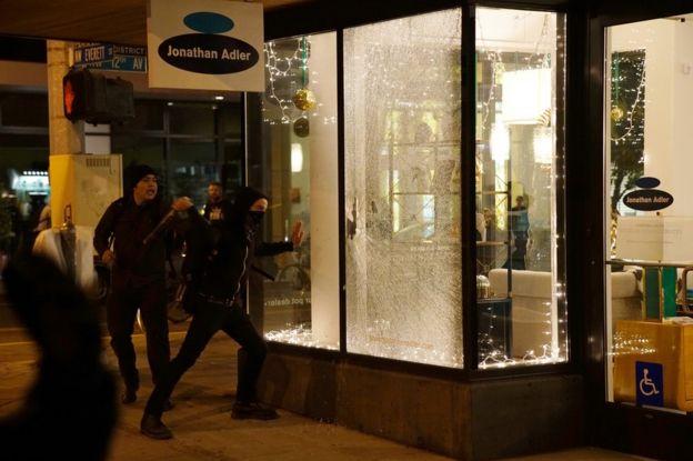 Damaged shop window in Portland, Oregon, 10 November