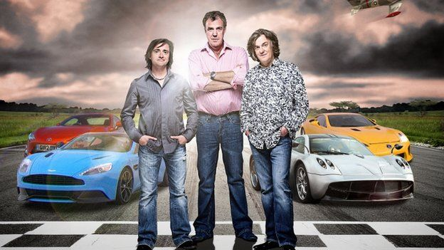 Richard Hammond, Jeremy Clarkson and James May stood in front of sports cars