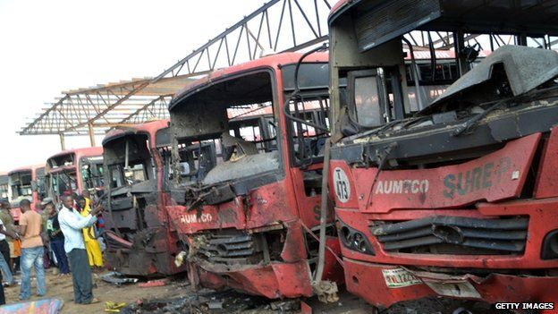 This picture taken on April 14, 2014 shows burnt buses after an attack in Abuja. Twin blasts at a bus station packed with morning commuters on the outskirts of Nigeria's capital killed dozens of people on April 14, in what appeared to be the latest attack by Boko Haram Islamists.