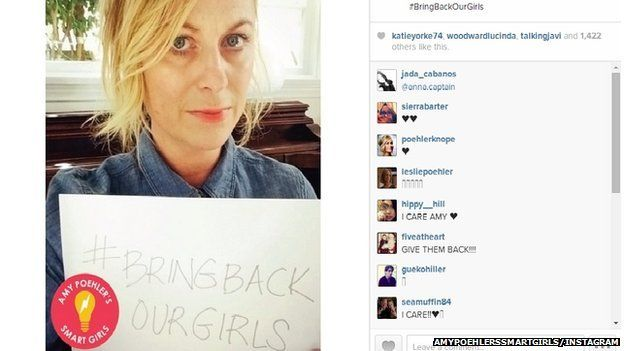 "Amy Poehler holding a sign reading: ""#Bring Back Our Girls"""