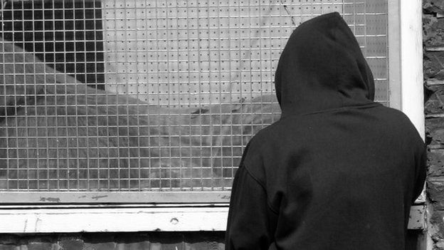 Teenager wearing a hoodie
