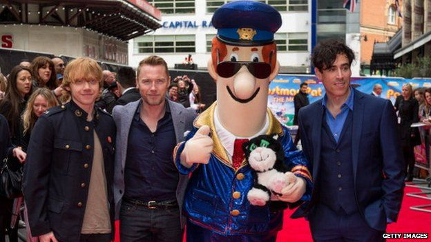 Rupert Grint (left) at the Postman Pat: The Movie premiere with co-stars Ronan Keating and Stephen Mangan