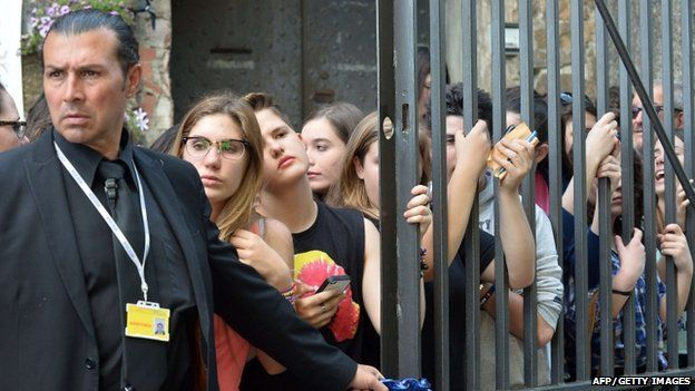 Fans outside Fort Belvedere in Florence, Italy