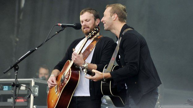 Kings of Leon were joined by Chris Martin on stage