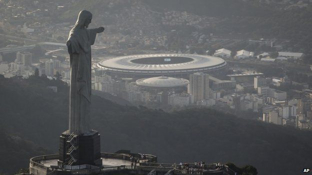 The Maracana stadium, pictured behind the Christ the Redeemer, will host the World Cup final on 13 July
