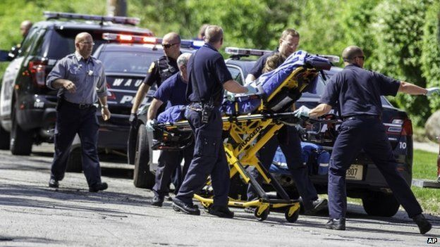 An unnamed stabbing victim is treated by authorities in Waukesha, Wisconsin, on 31 May 2014