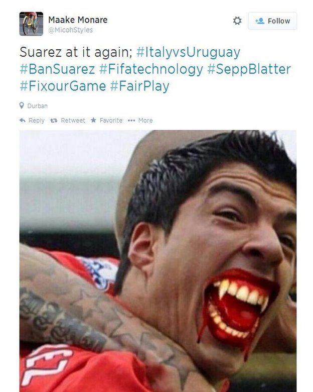 Image taken from Twitter of Suarez with fangs
