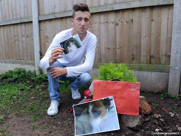 Nicholas Murphy knelt by Gunner's grave