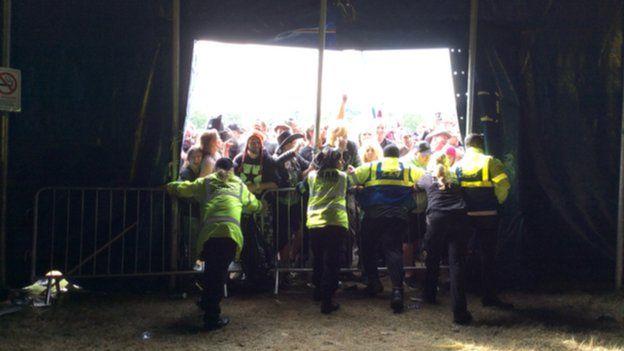 Stewards hold back crowds