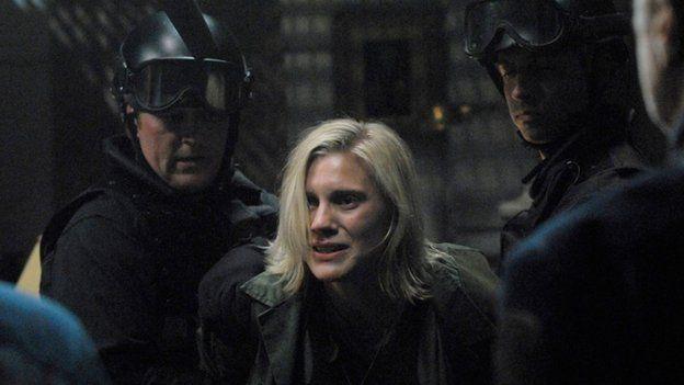 Katee Sackhoff as Lieutenant Kara 'Starbuck' Thrace in Battlestar Galactica