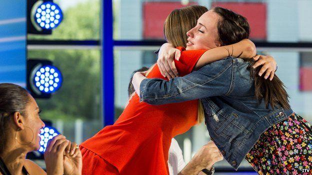 Cheryl hugging a contestant