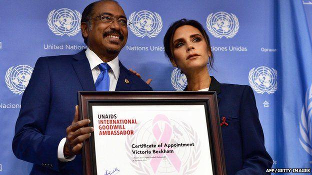 Michael Sidibe and Victoria Beckham