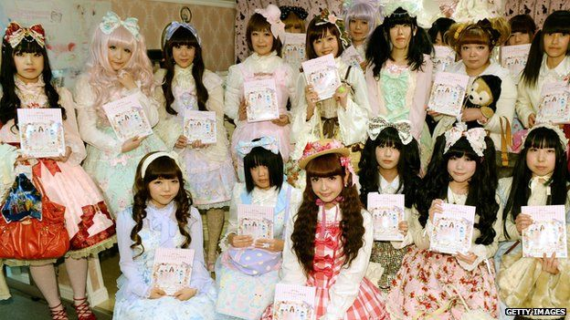 Fans dressed in gothic-inspired 'Lolita' outfits pose with Japan's Lolita-style fashion leader Misako Aoko