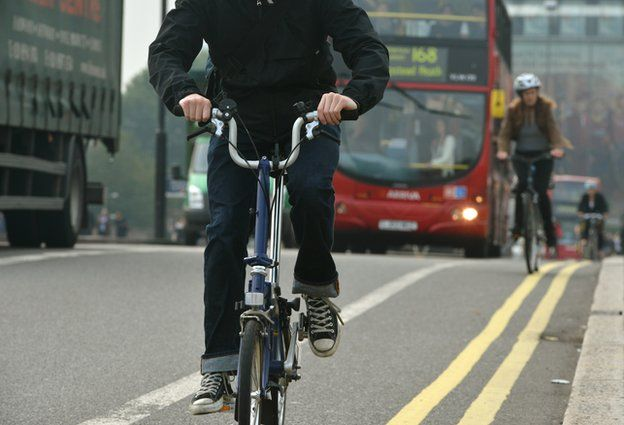 Cyclists and a bus