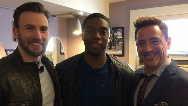 Robert Downey Jr (right) appeared with Captain America co-stars Chris Evans (left)and Chadwick Boseman