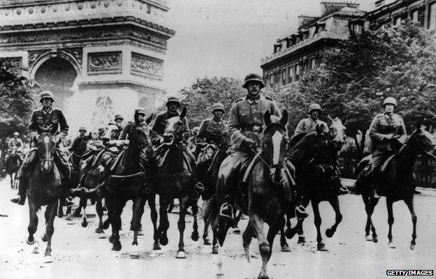 German troops ride through Occupied Paris