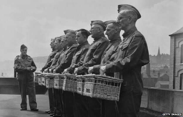Members of the Home Guard with their racing pigeons in Blackburn, Lancashire in 1940. The pigeons were being trained as messengers.