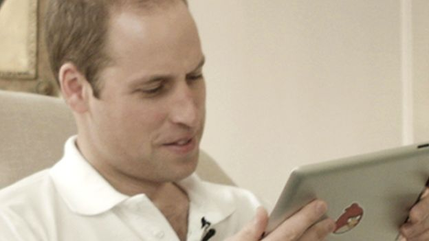 Prince William playing Angry Birds on an iPad