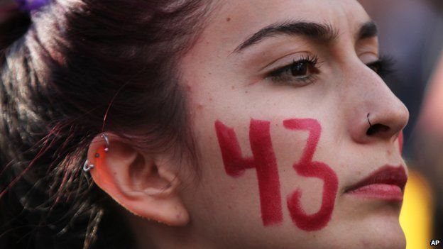 Woman with 43 painted on her cheek