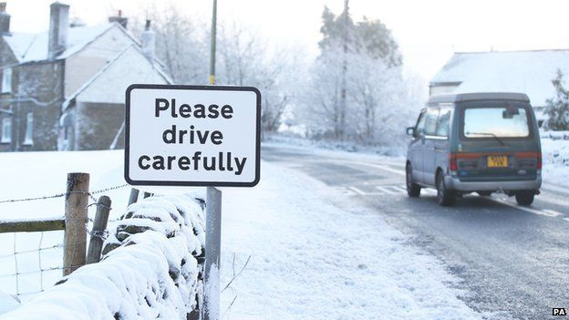 """Road sign reading: """"Please drive carefully"""""""