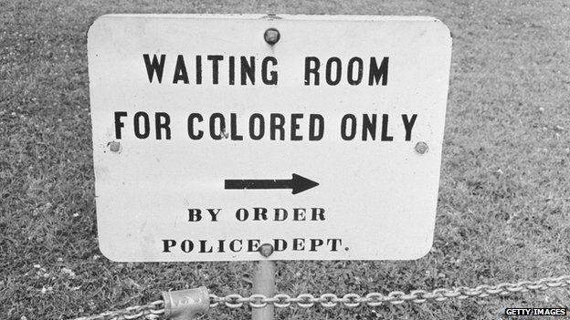 "Sign reading: ""Waiting room for colored only by order of police dept."""